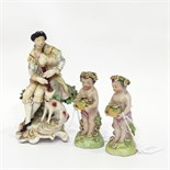 19th century Capodimonte porcelain figure group of gentlemen and pipes, with dog by his side,