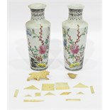 Pair of Oriental porcelain vases with tall flared necks, circular tapering form, floral decoration,