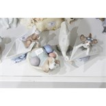 Lladro model of a puppy in a paper boat, another on a paper aeroplane,