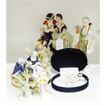 German porcelain figure group of a courting couple, 17cm high, with blue crowned 'K' mark to base,