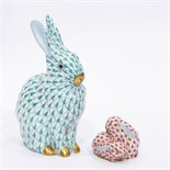 Herend model of a rabbit with green decoration, 13cm high and a Herend model group of two rabbits,