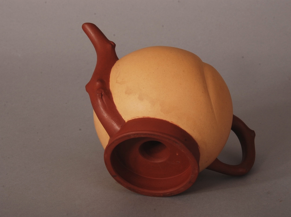 Lot 27 - C19th Chinese Zisha teapot, modelled as a peach with knobbled handle and spout, 18.2cm wide