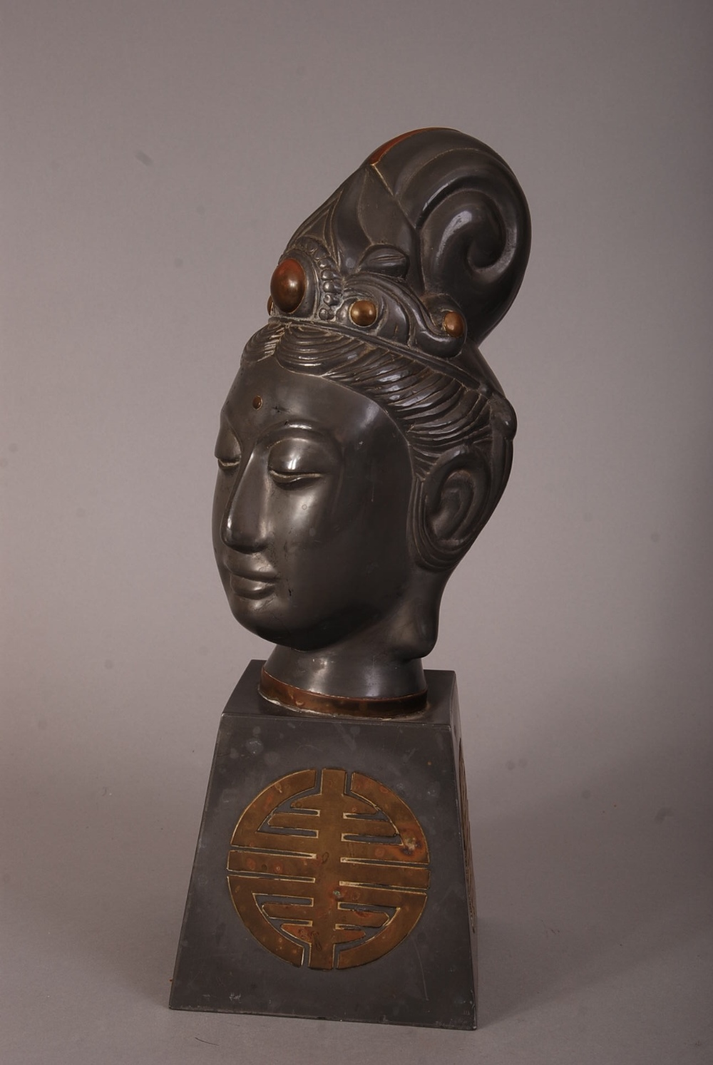 Lot 44 - C19th/20th Chinese brass-inlaid pewter Guanyin head, 36.6cm high
