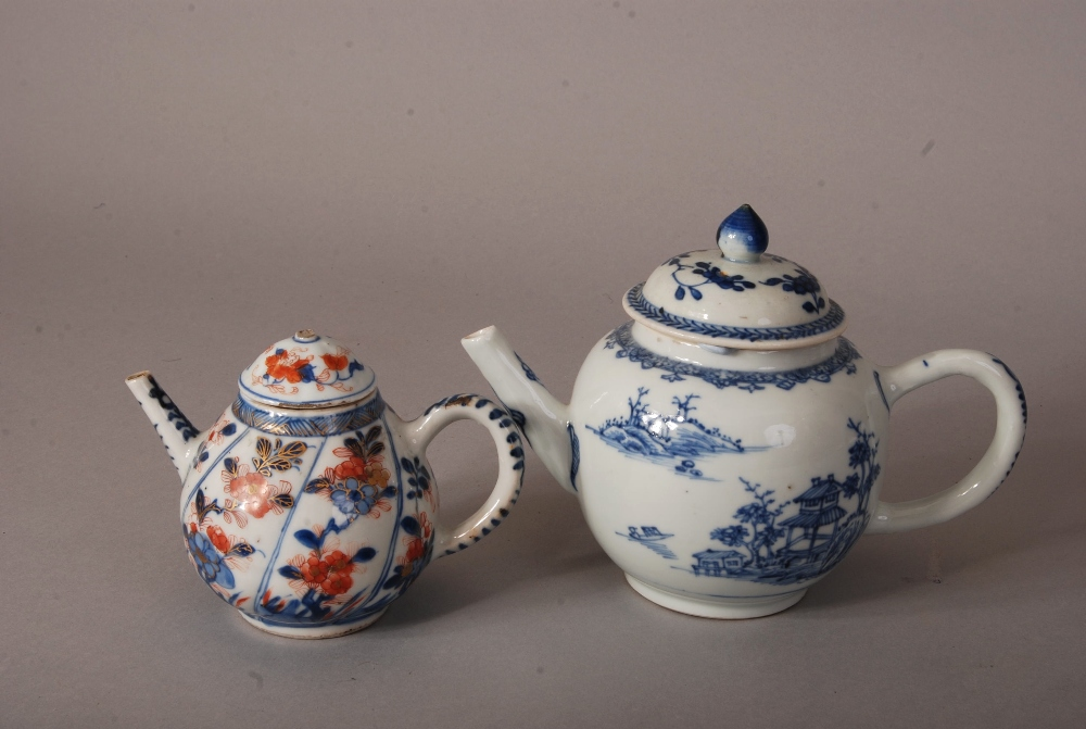 Lot 25 - C18th Chinese blue and white teapot and cover painted with landscape, 21cm wide; together with a
