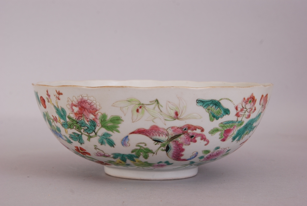 Lot 13 - Chinese famille rose bowl, painted overall with butterflies and blossoming floral sprigs, Daoguang