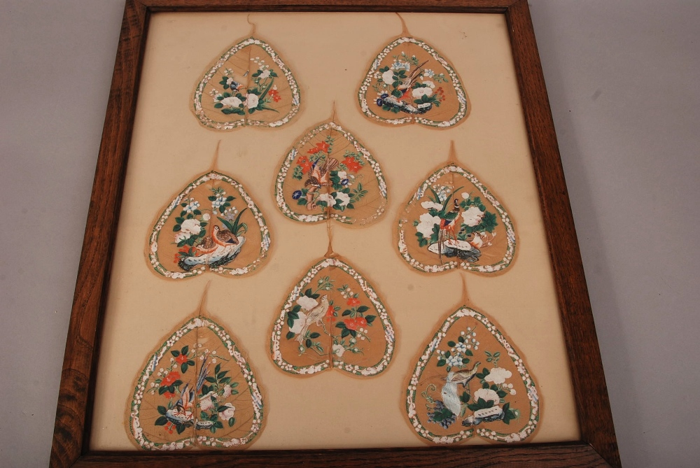 Lot 48 - C19th Chinese mounted set of eight Bodhi leaf paintings of birds and flowers, all mounted within a