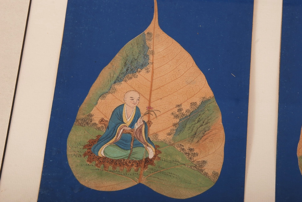 Lot 47 - C18th Chinese mounted set of six Bodhi leaf paintings of Luohan, each painted to depict a Luohan,