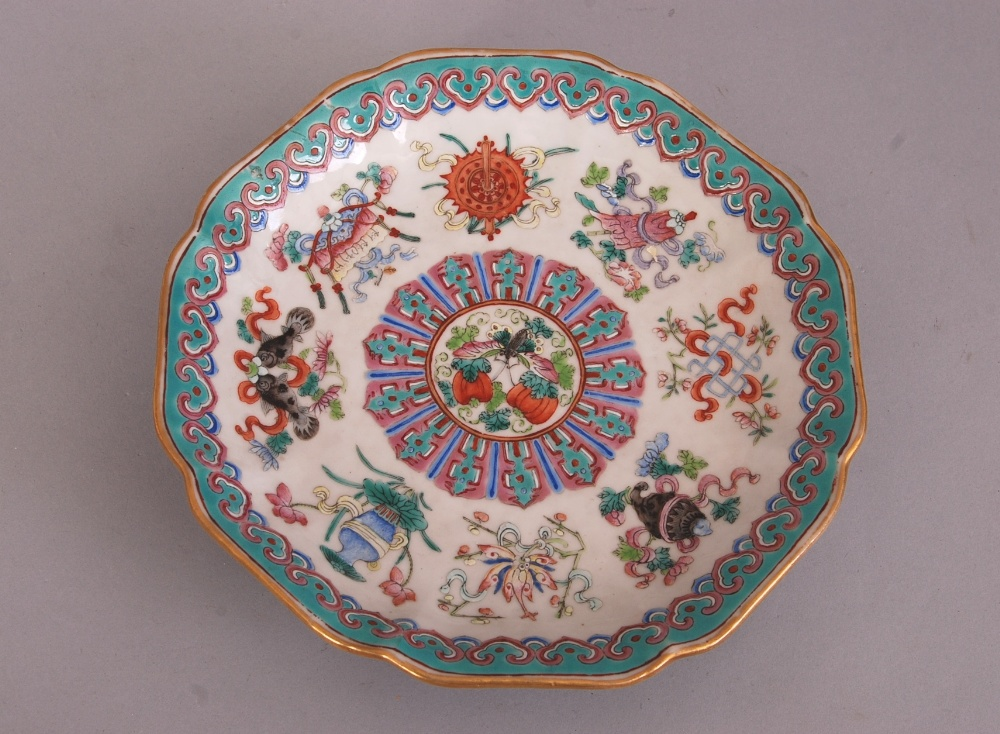 Lot 11 - Chinese famille rose octagonal plate, painted with the Eight Buddhist emblems to the interior, and