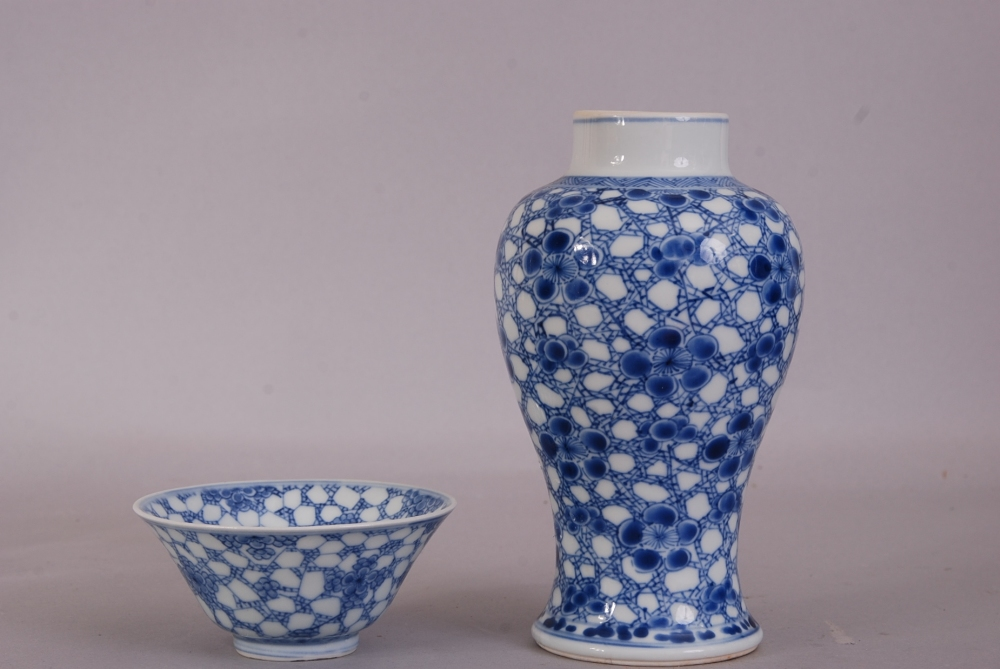 Lot 3 - Chinese blue and white baluster vase, painted with prunus on a cracked-ice ground, Kangxi, 17cm