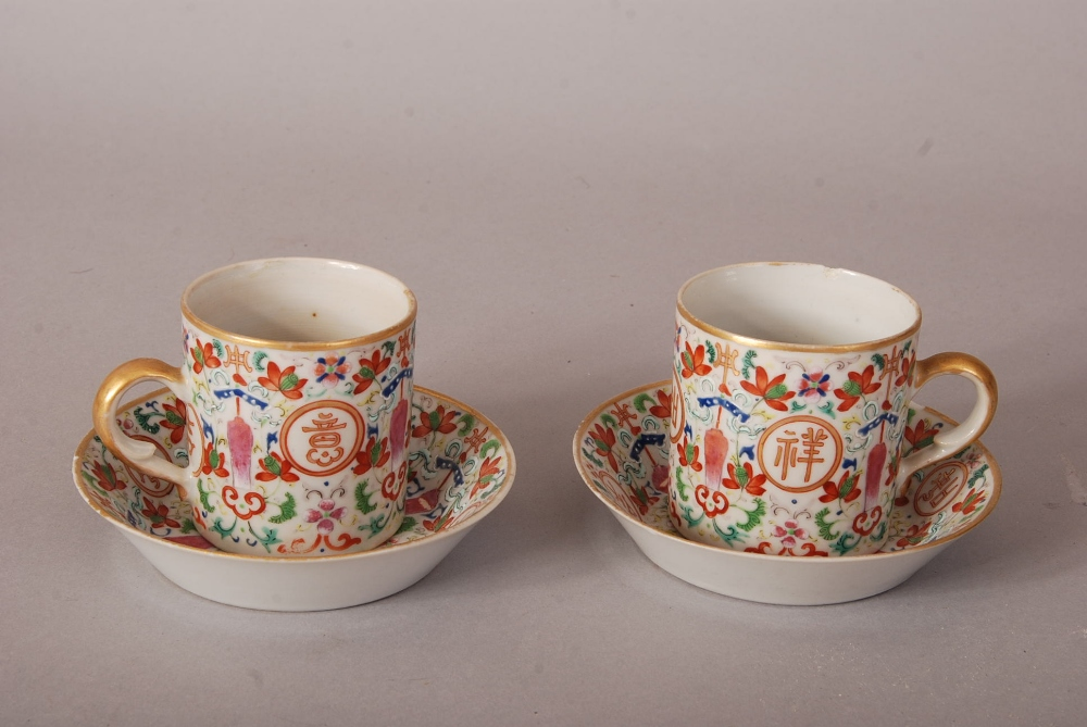 Lot 41 - Pair of C19th Chinese famille rose cups and saucers, painted with four medallions enclosing