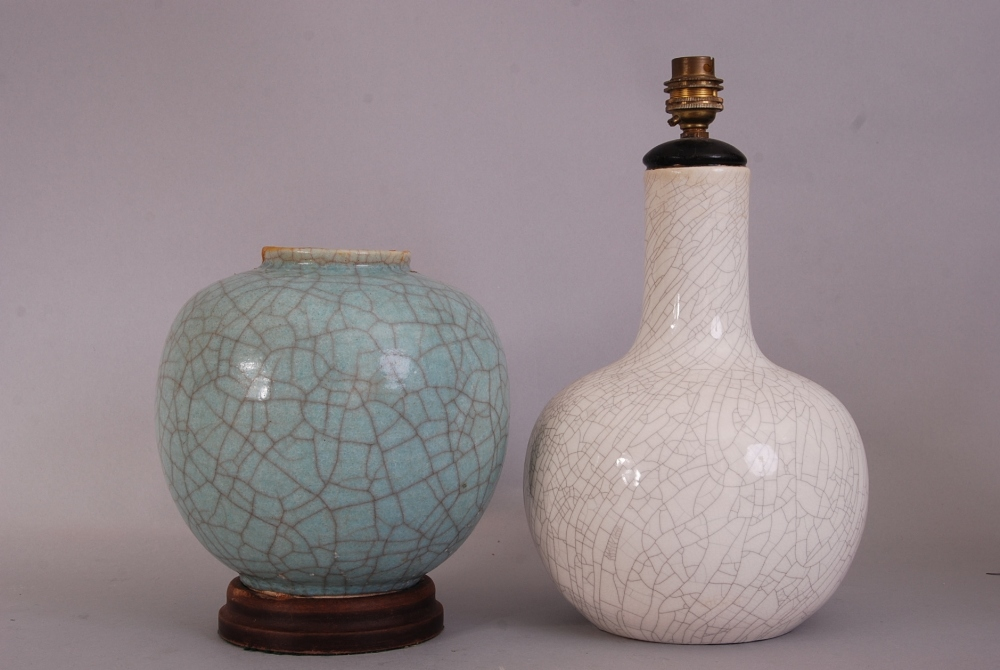 Lot 10 - C19th Chinese pale green crackle-glazed jar, 21.5cm high, wood stand; together with a white