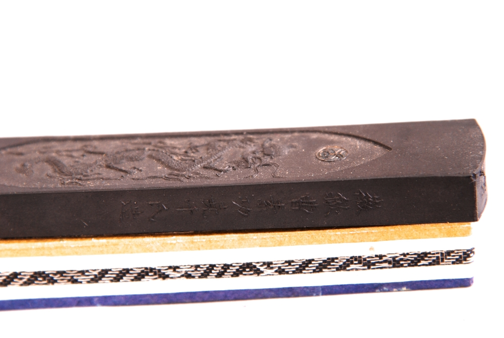 Lot 21 - A group of nine C19th/20th Chinese ink cakes, of rectangular form and each decorated with