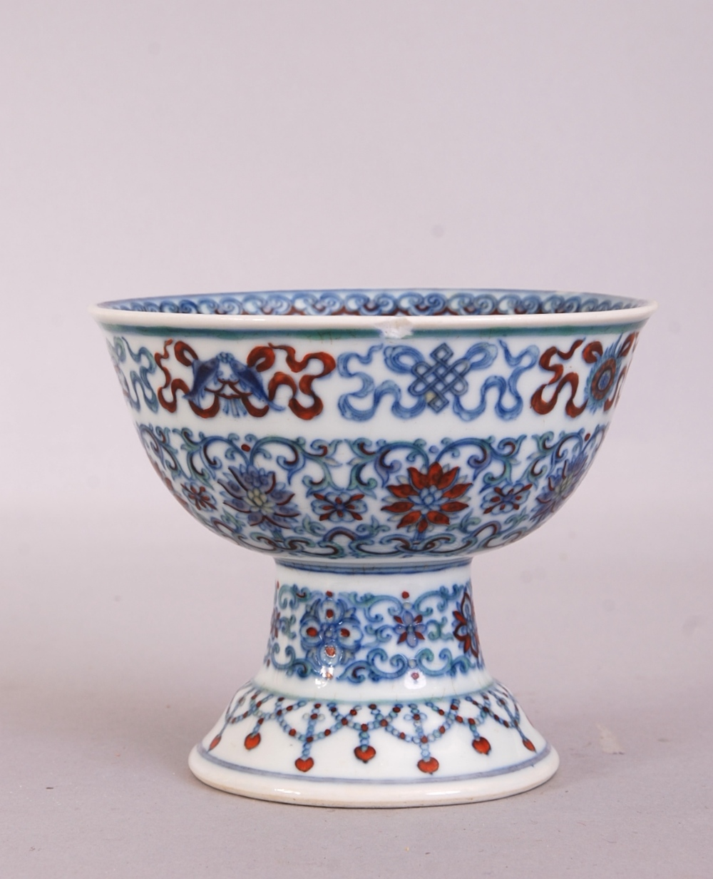 Lot 7 - C18th Chinese Doucai stem bowl, painted to the exterior with scrolling lotus flowers and the Eight