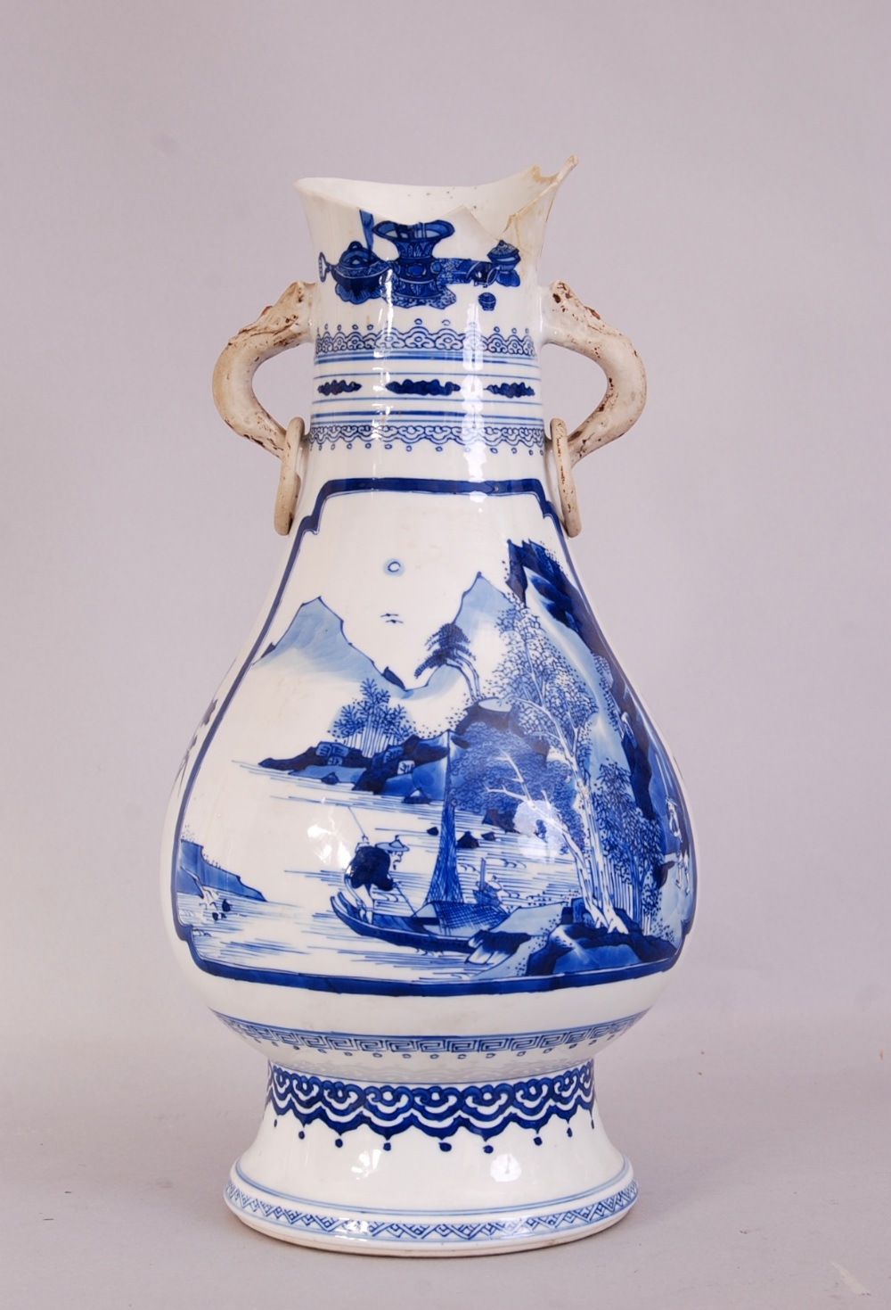 Lot 9 - Chinese blue and white twin-handled vase, painted to both side with a panel depicting figures in a