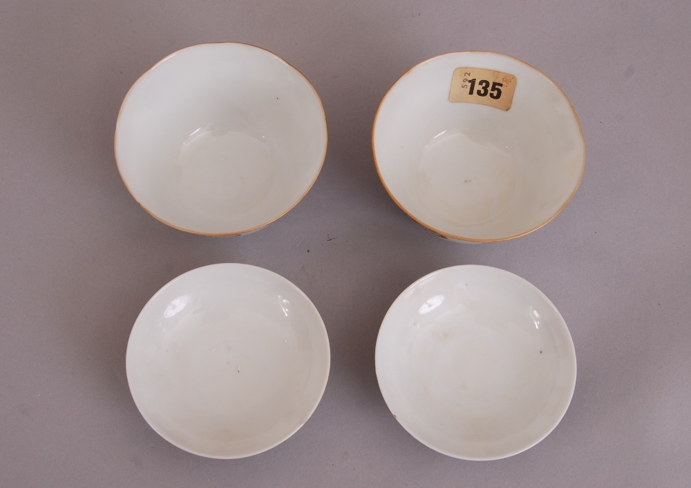 Lot 40 - Pair of Chinese 'seal' bowls and covers, decorated with various seal marks in different shapes,