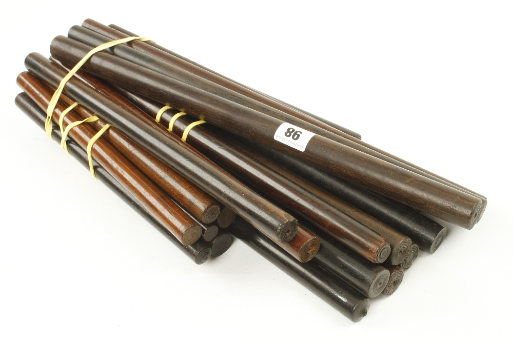 Lot 98 - 21 ebony and rosewood rolling rules G+