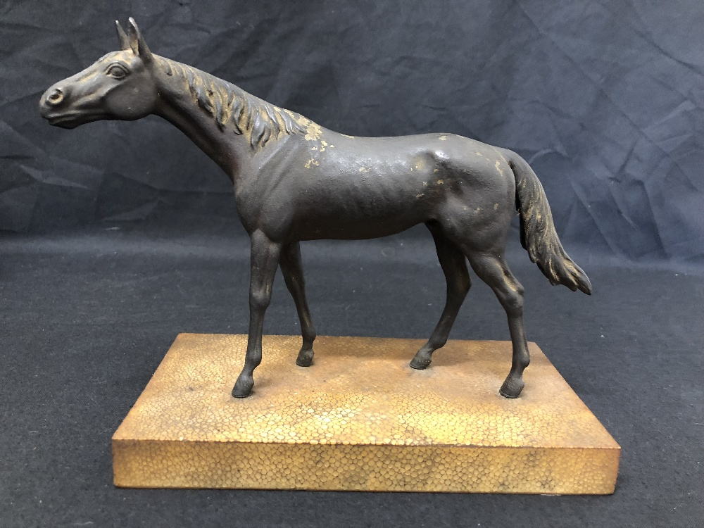 Lot 16 - A metal horse painted as bronze, mounted on a wooden base.