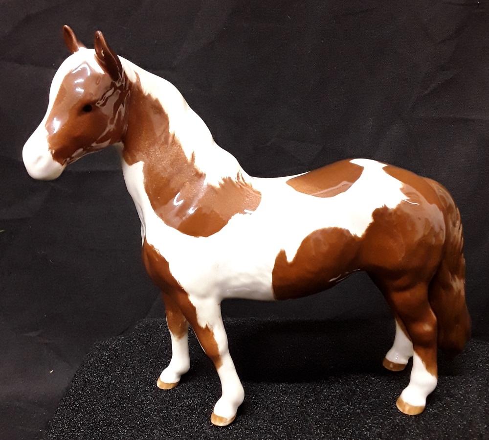 Lot 26 - A Beswick horse.
