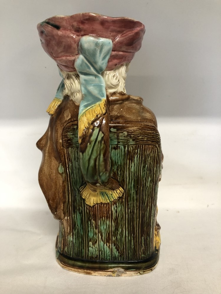 Lot 39 - Falstaff Toby – A perfect jug by Edward Steel, Majolica ware, registration lozenge to the base.