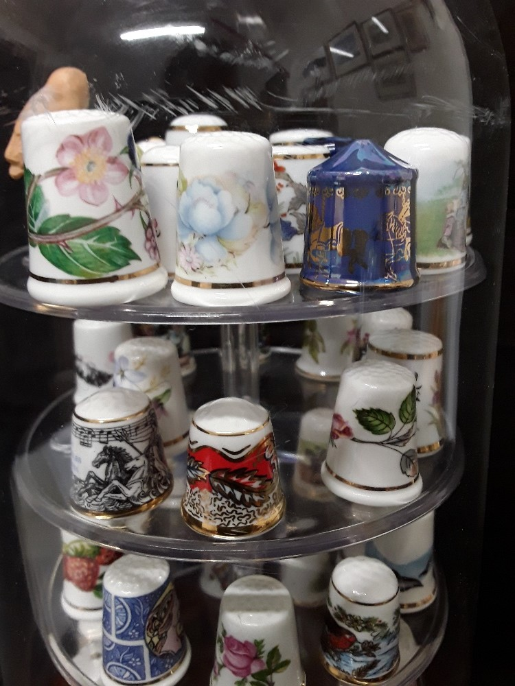 Lot 6 - An assortment of porcelain thimbles by various makers and in an assortment of designs.