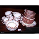 A Minton part tea and coffee set, decorated floral swags, forty-eight pieces approx