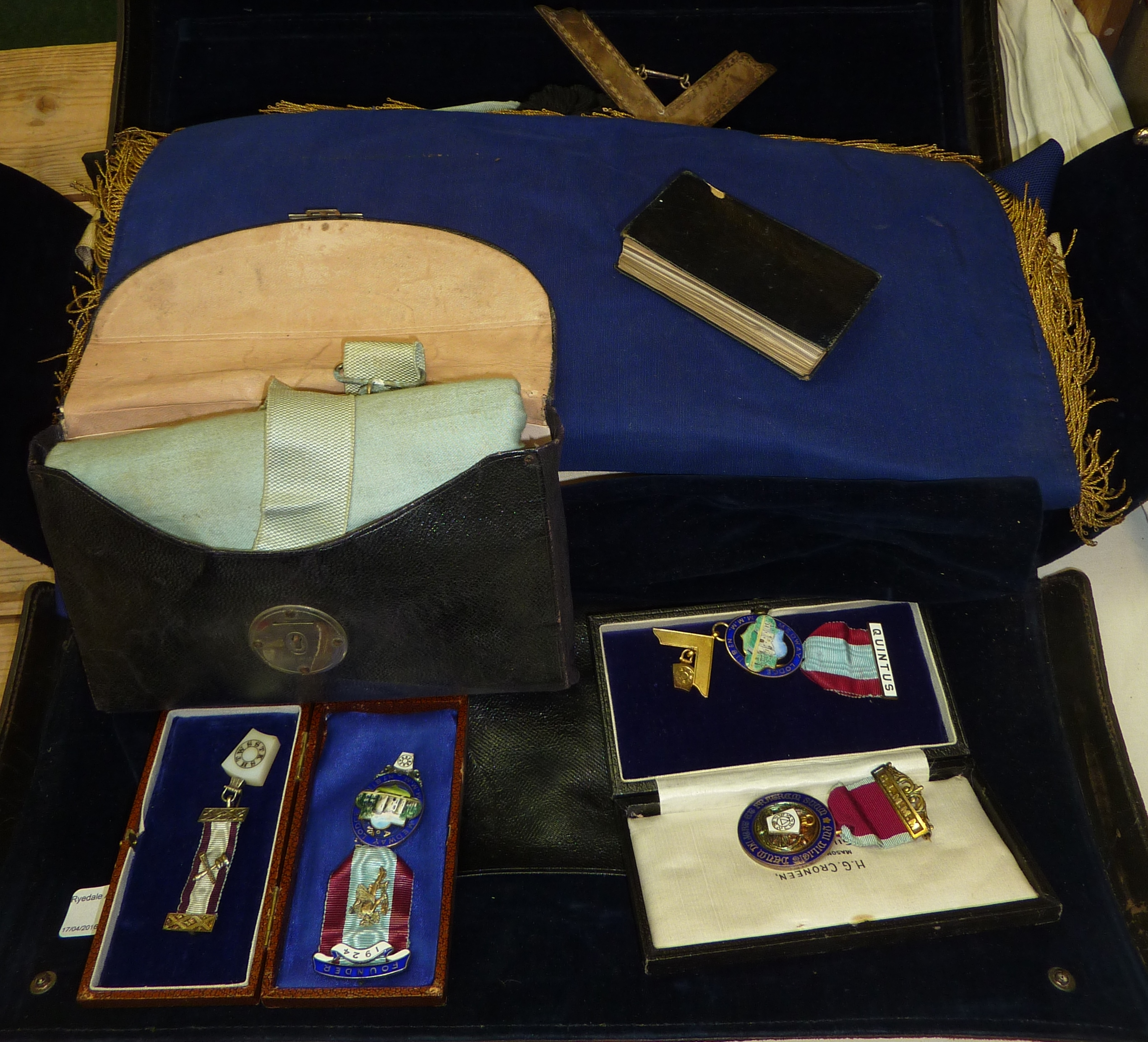 Leather Masonic Case containing a selection of Masonic aprons