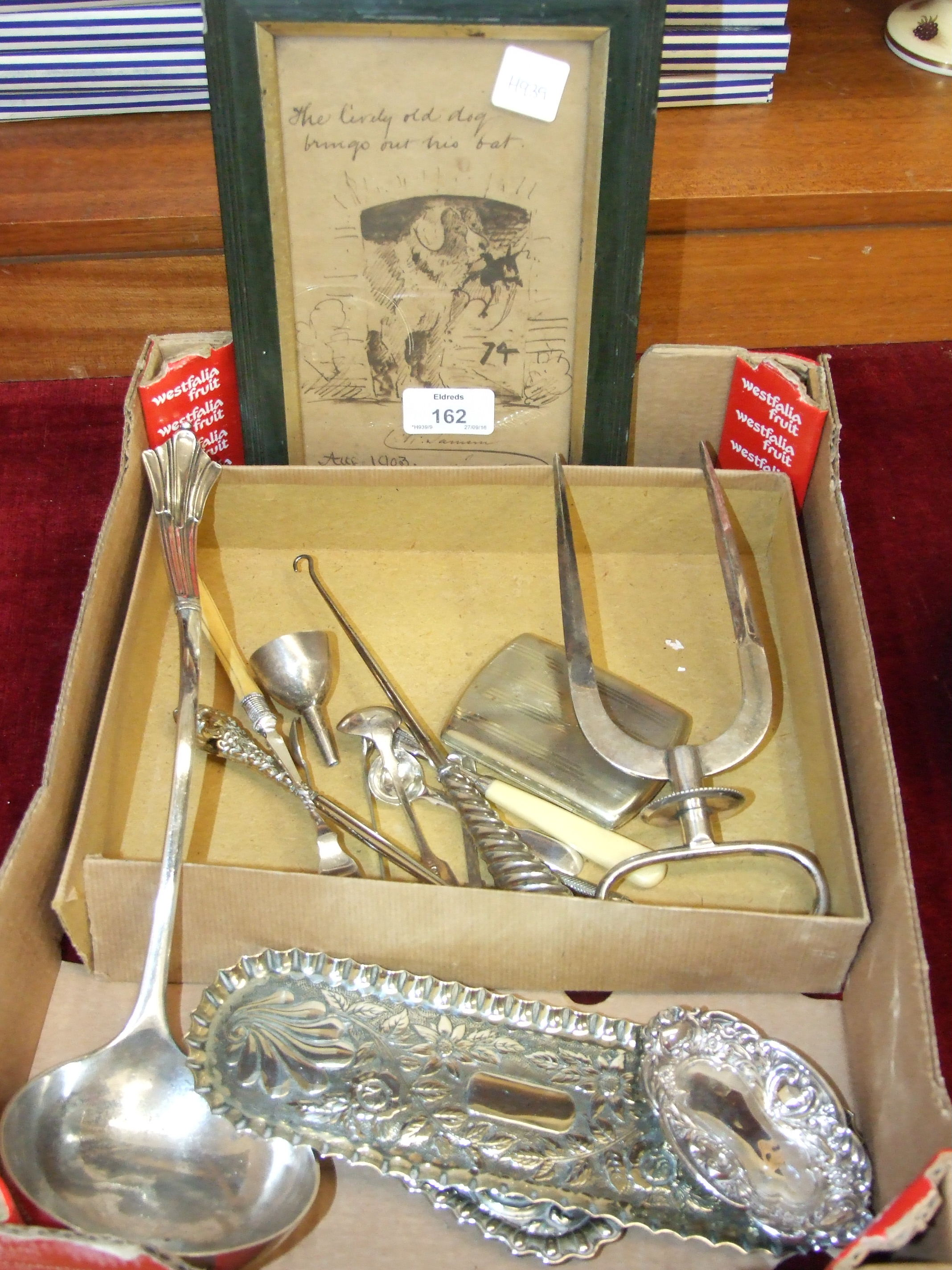 Lot 162 - A plated joint lifter, a plated ladle, other plated ware and a framed pen and ink sketch 'The lively