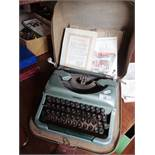 1960's portable Imperial typewriter, with original guarantee!