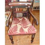 19th c. mahogany scroll-arm library elbow chair on turned and carved legs