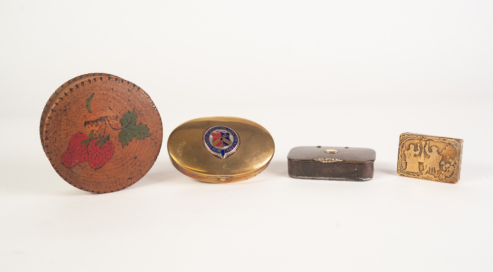 Lot 444 - AN OVAL BRASS SNUFF BOX, the hinged covered centred with an enamelled coat of arms and motto