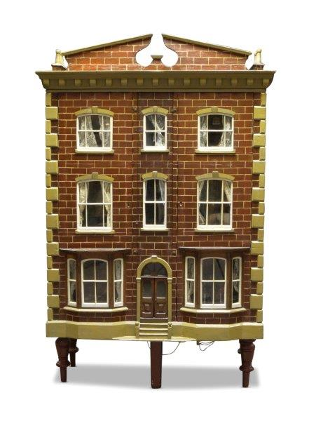 A six room painted wood dolls house, late 19th/early 20th century, the roof with two sections of