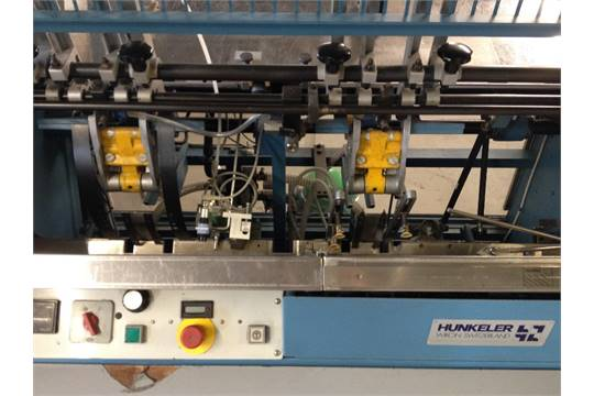 HUNKELER INSERTING MACHINE WITH ROBATECH GLUE HEAD AND BAMBI
