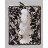 AN ENAMELED SILVER PENDANT WITH A WHITE JADE GUANYIN, LATE QING OR REPUBLIC Silver with black