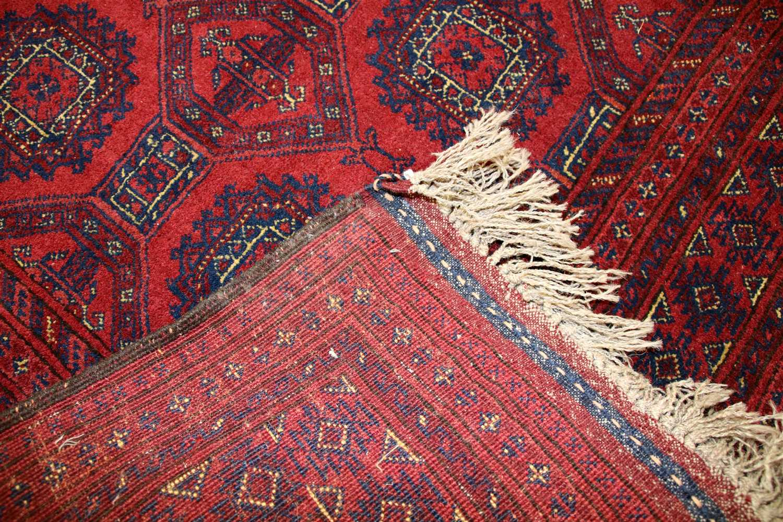 Lot 619 - A red ground Turkoman rug