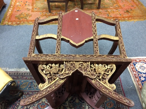 Lot 793 - A Cambodian carved frame throne seat, the back panel decorated a deity,
