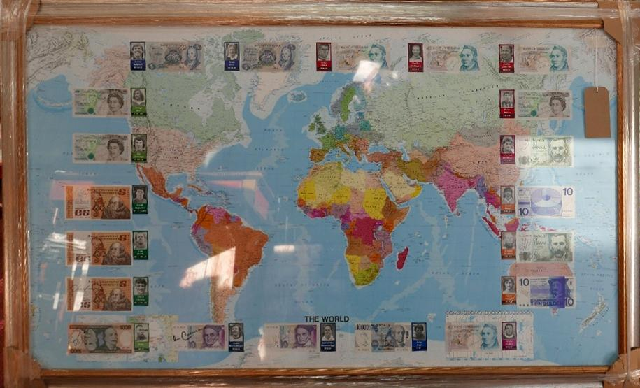 Lot 7 - A sporting interest, a map of the world mounted with international currency signed by famous