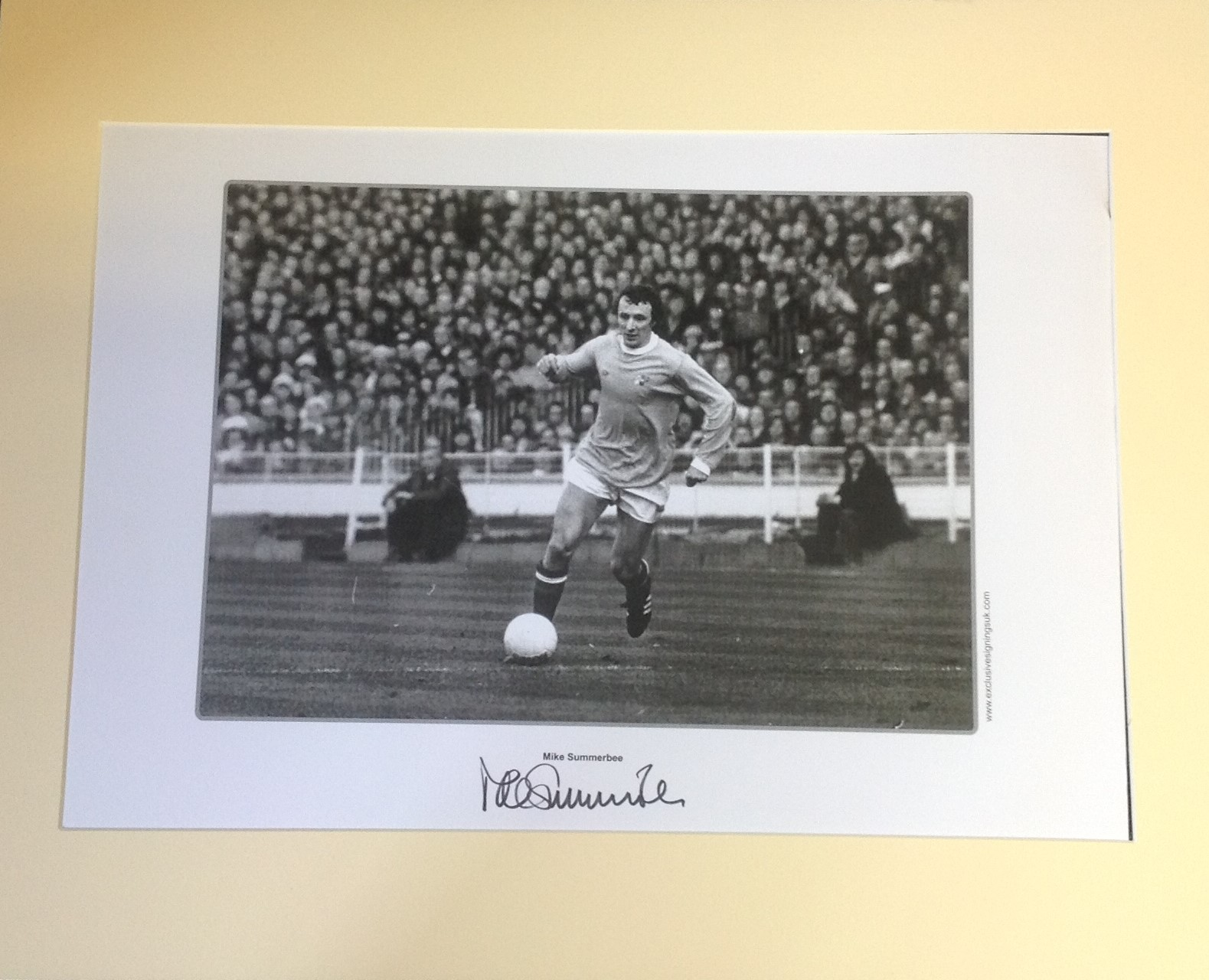 Lot 59 - Football Mike Summerbee signed 16x20 mounted b/w photo pictured in action for Manchester City.