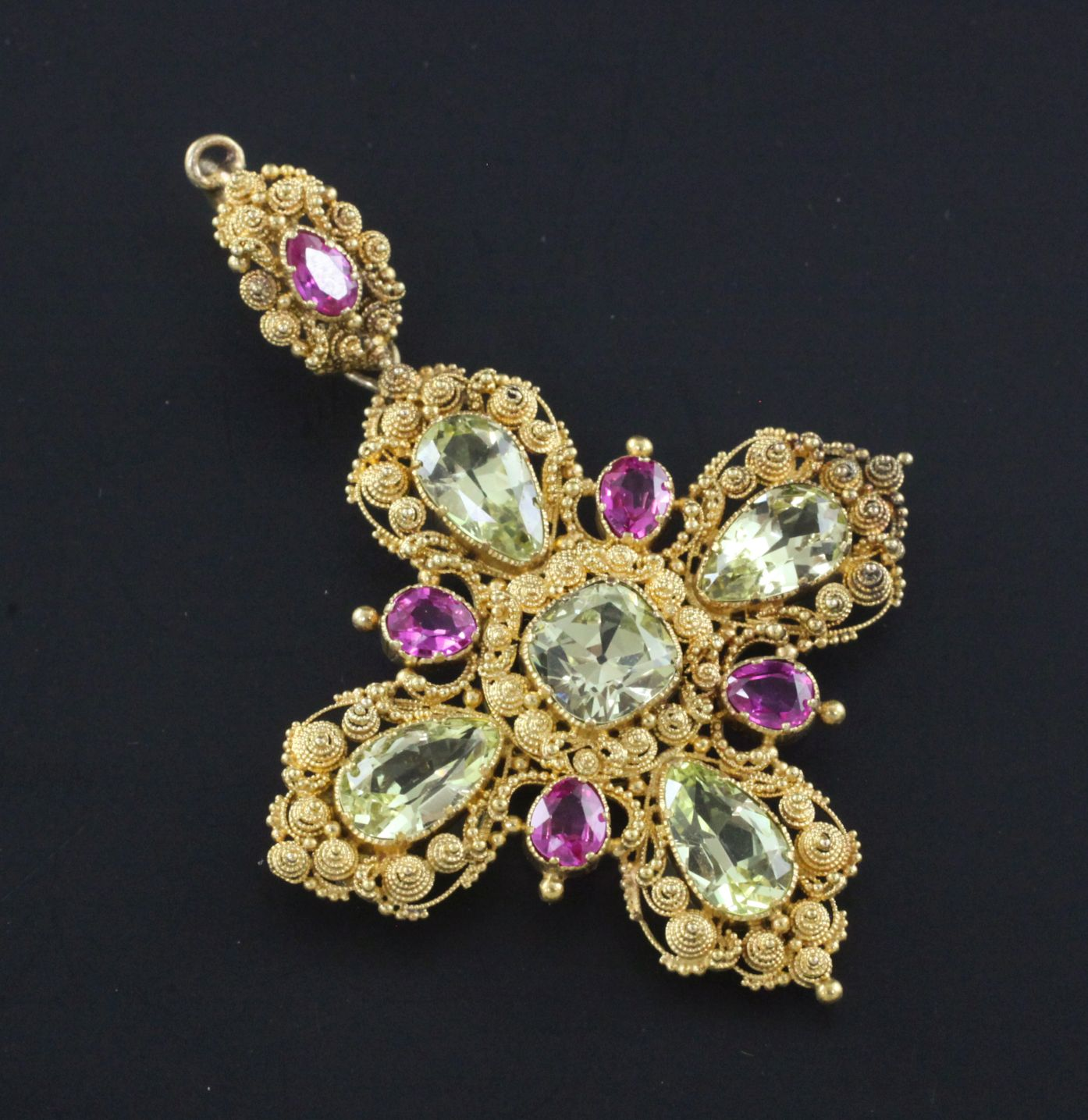 A late Victorian gold, ruby and pale green sapphire set cross pendant, with cannetile work