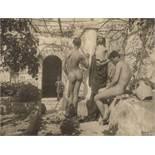 Gloeden, Wilhelm von: Young male nudes on terrace with trellis