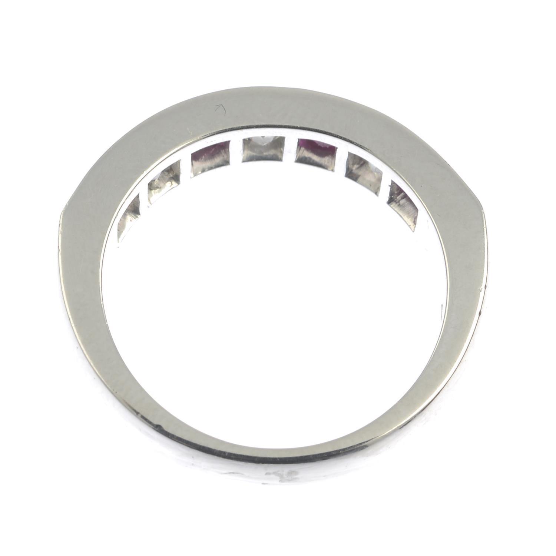 Lot 141 - A platinum square-shape ruby and diamond half eternity ring.