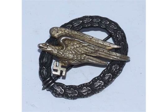 A WW2 German LuftWaffe Fallschirmjager badge, the back
