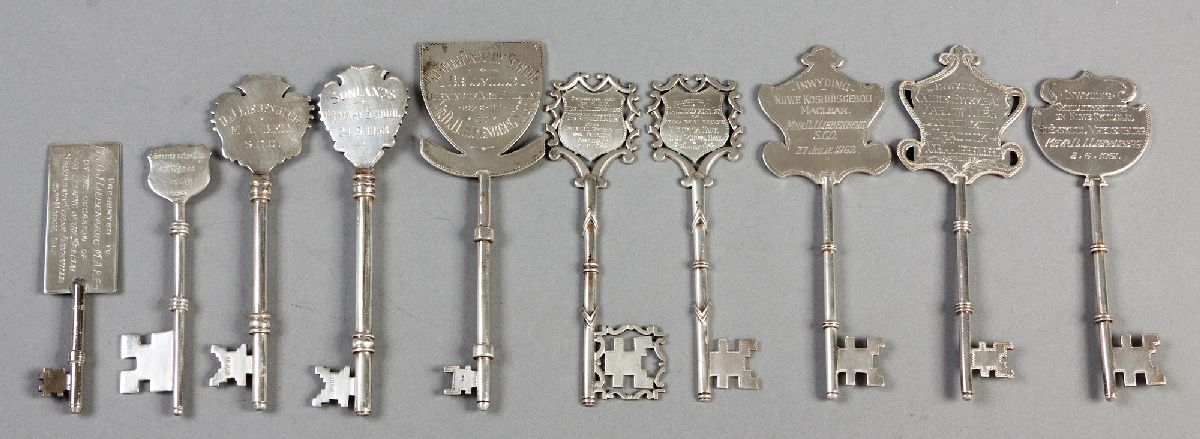 Lot 17 - A COLLECTION OF TEN STERLING SILVER PRESENTATION KEYS, of various shapes, sizes and inscriptions,