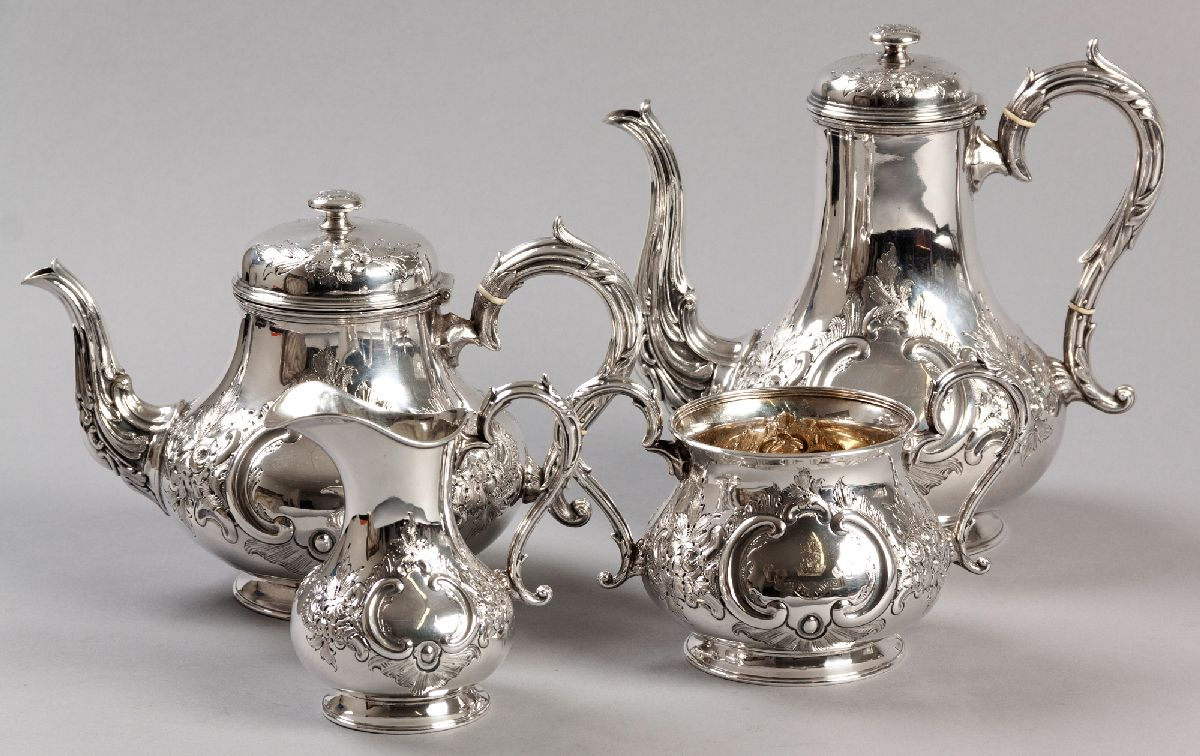 Lot 39 - A FOUR PIECE SILVERPLATE TEA AND COFFEE SERVICE, comprising: of a teapot, coffee pot, creamer and