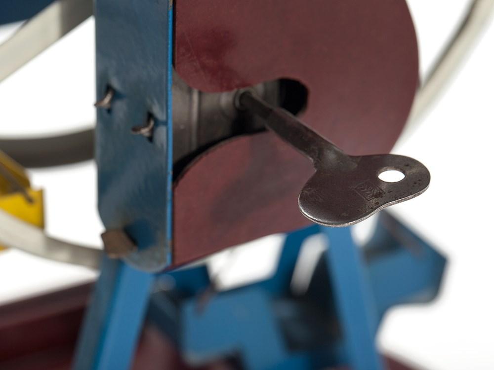 """Lot 25 - Fancy money box """"Ferris wheel"""", Germany, 1930-50s Painted tin, bakeliteGermany, 1930-50sClockwork"""