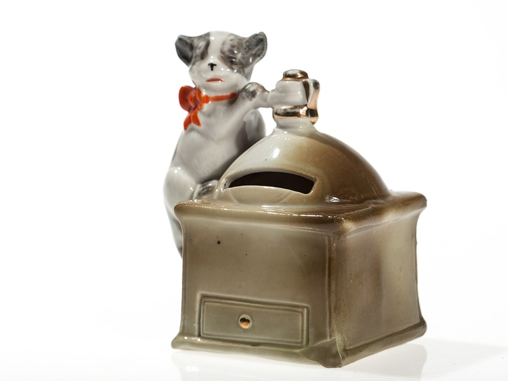 """Lot 15 - Cute still bank """"Coffee mill with cat"""", Germany, around 1910 Ceramic, paintedGermany, around"""
