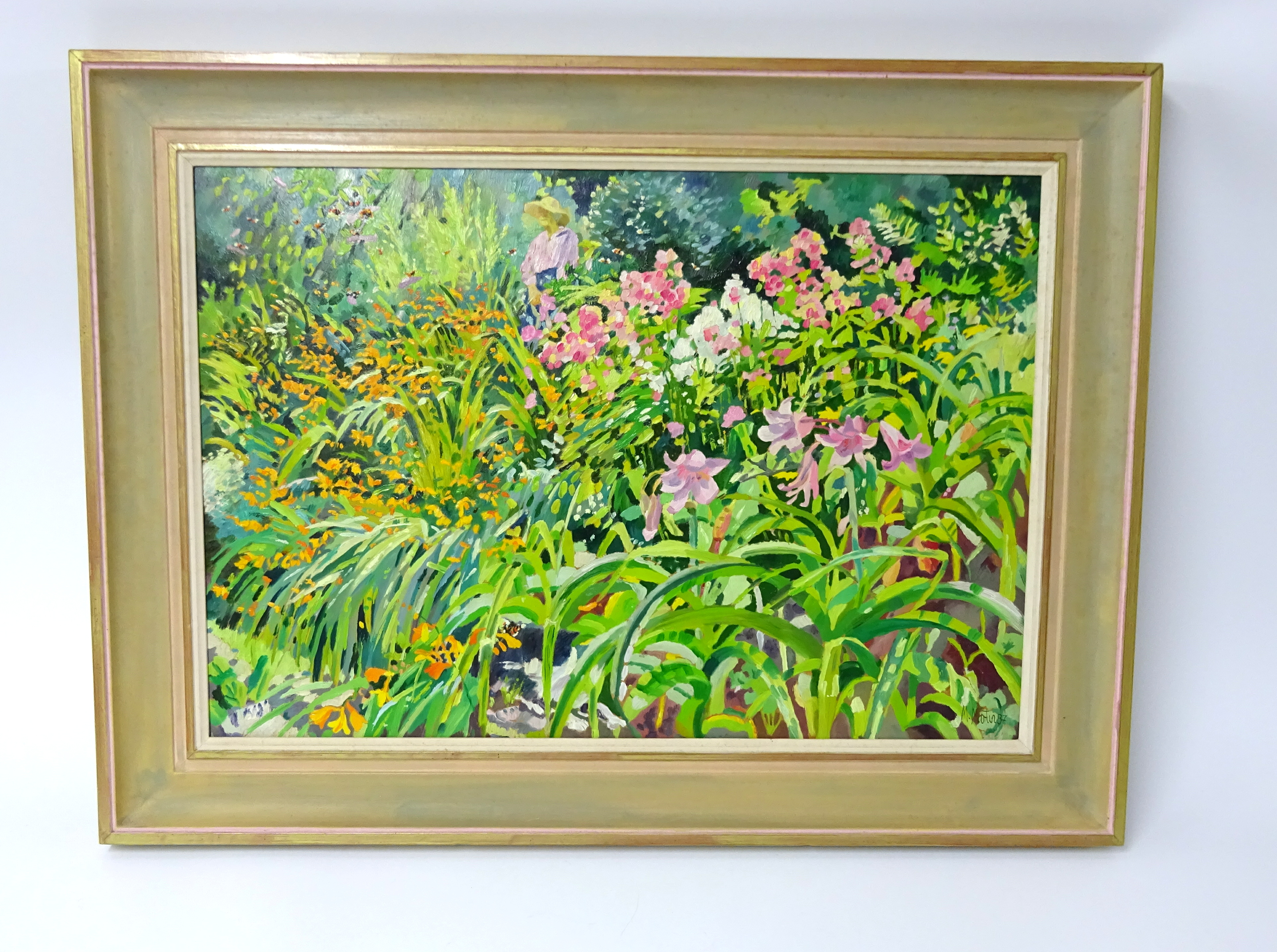Lot 002 - Mary Martin (b1951) oil on board, 'Figure in a Summer Garden', signed, 45cm x 67cm.
