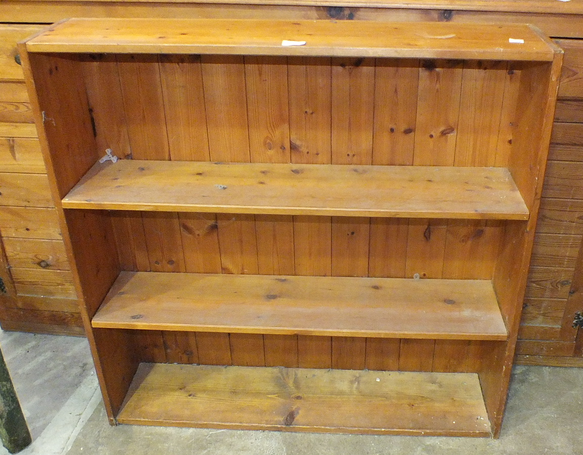 Lot 24 - A hanging pine wall shelf fitted with a mirrored door and two small drawers, 76.5cm wide, 72cm high,