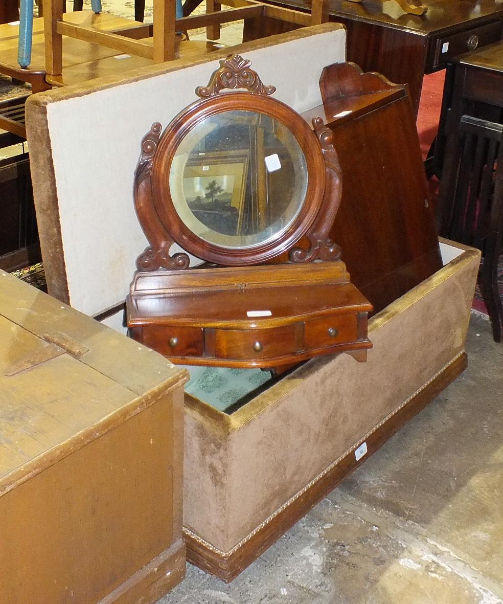 Lot 40 - An upholstered oak Ottoman box, 87cm long, a single-door mahogany medicine cupboard, 65cm high, 41cm