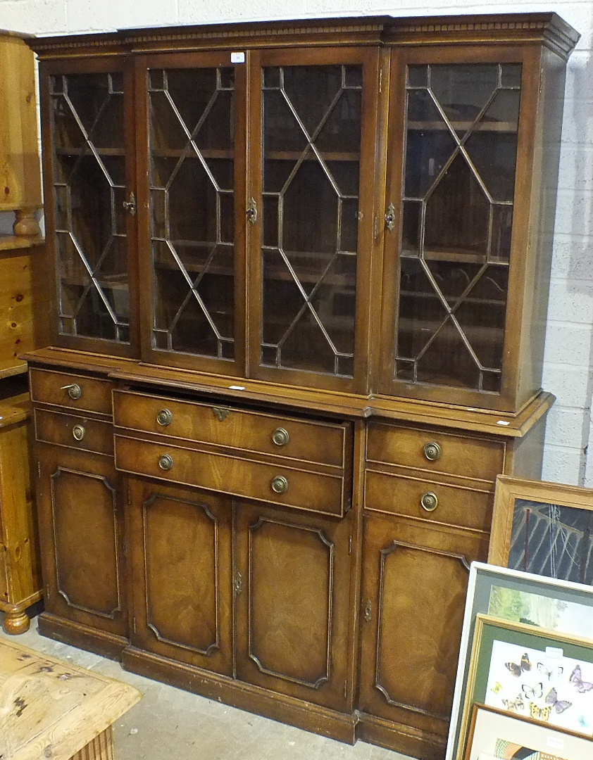 Lot 55 - A Georgian-style secretaire/library bookcase by Reprodux, having four astragal-glazed doors over