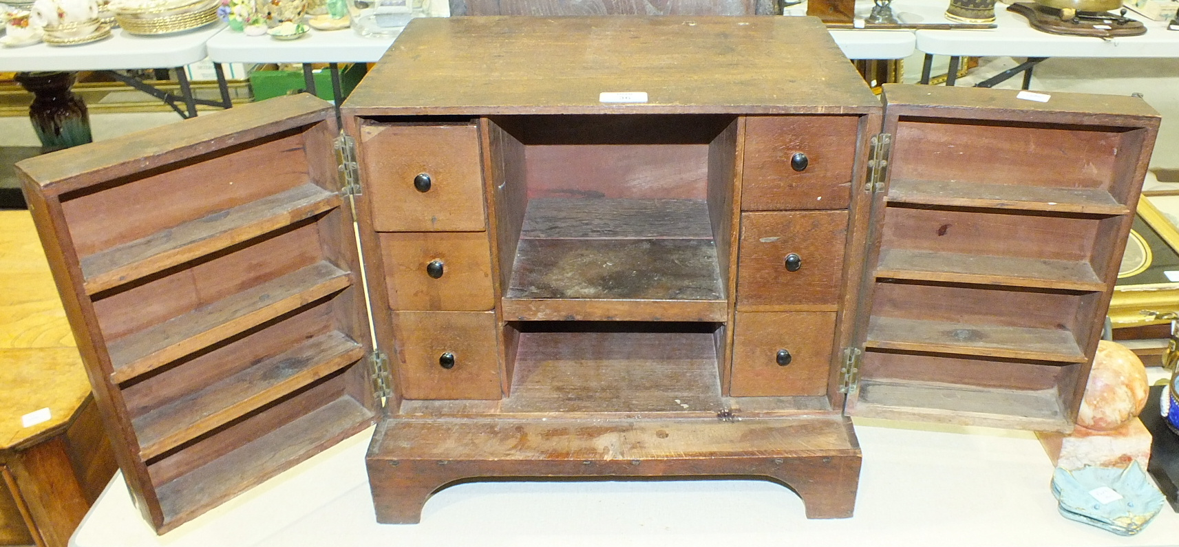 Lot 36 - An antique oak chest of two drawers constructed from old timber, 43 x 33cm and a mahogany two-door